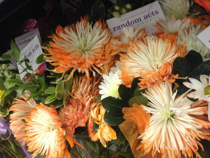 Orange and white mums with delivery cards